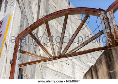 Rusted Gate Wrapped in Barbed Wire - Stock Image