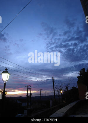 Dusk in traditional Greek village, looking over countryside - Stock Image