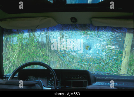 Car front glass spoiled seen from the inner side of the car - Stock Image