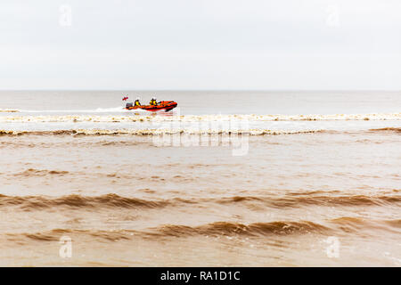 Mablethorpe, Lincolnshire, UK. 30th December 2018. Mablethorpe coastguard practicing maneuvers  in the open sea on the East coast of the UK at Mablethorpe, Lincolnshire on 30/12/2018 RNLI coastguard in boat in the sea in RNLI lifeboat Credit: Tommy  (Louth)/Alamy Live News - Stock Image