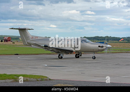 Pilates PC12/47E LX-JFR single engine turboprop aircraft parked at Inverness Airport in the Scottish Highlands. - Stock Image