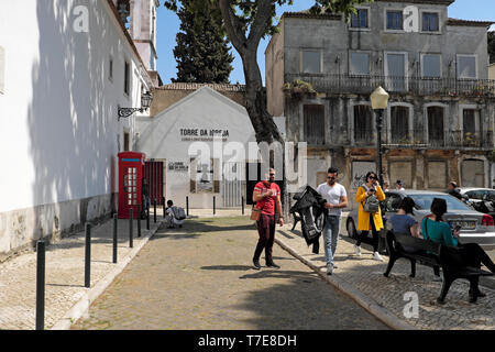 Tourists in the street outside the tourist attraction bell tower Torre da Igreja do Castelo de São Jorge Lisbon Portugal Europe EU  KATHY DEWITT - Stock Image
