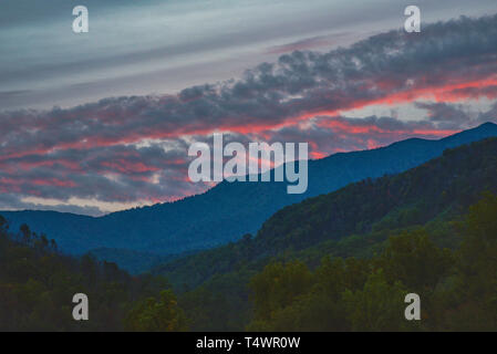 Early morning sunrise from a mountain vista point in the Great Smoky Mountains National Park in autumn, outside Gatlinburg, TN, USA - Stock Image