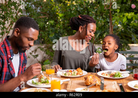 A family eating lunch together - Stock Image