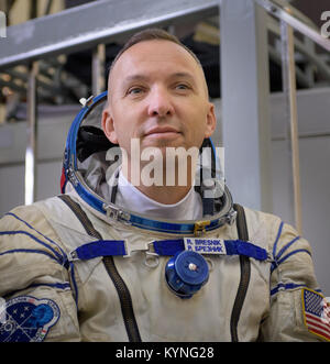 Expedition 52 flight engineer Randy Bresnik of NASA listens to questions from the press outside the Soyuz simulator - Stock Image