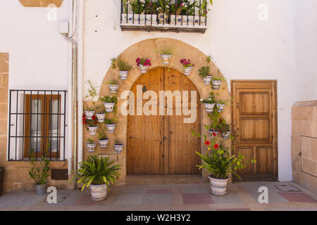 Xabia Spain front door with plants pots and flowers church in the historic Spanish town - Stock Image