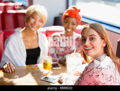 Portrait confident, smiling young women friends dining in restaurant - Stock Image