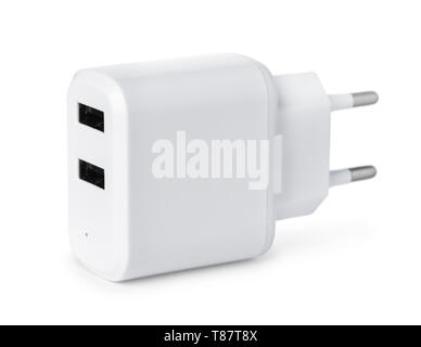 Double USB wall charger plug isolated on a white - Stock Image