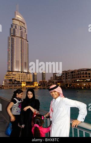 Arabian children in front of The Adress Five Star Hotel near Burj Khalifa and Dubai Mall,  - Stock Image