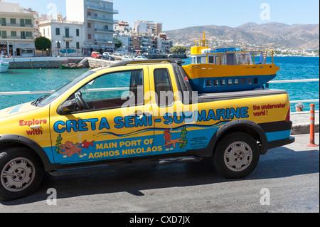 Pickup truck with model of Creta semi submarine tourist boat Agios Nikolaos Crete Greece - Stock Image
