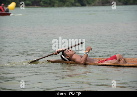 Palmas, Brazil. 30th October, 2015. A Matis competitor lies back in relief after his heat in the canoeing event - Stock Image