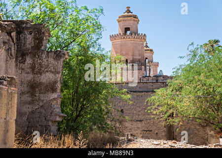View of the front towers of the Hacienda de Jaral de Berrio from the old Mescal distillery in Jaral de Berrios, Guanajuato, Mexico. The abandoned Jaral de Berrio hacienda was once the largest in Mexico and housed over 6,000 people on the property. - Stock Image