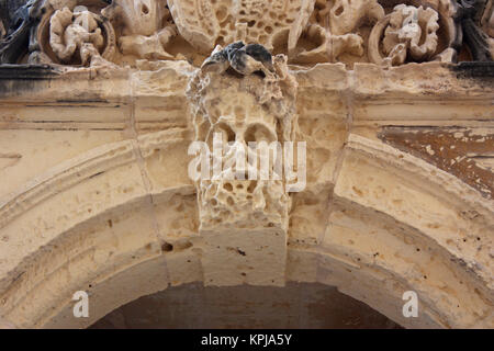 Arch keystone in the form of an eroded stone face in the ruined opera house, South Street, Valletta, Malta - Stock Image
