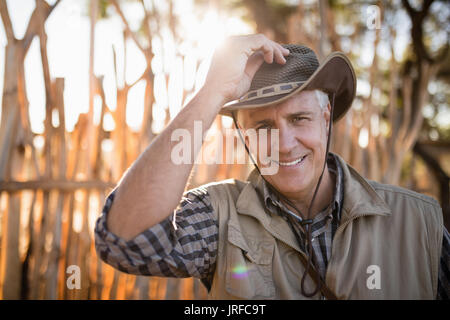 Senior man standing at the resort - Stock Image