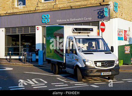 Supermarket delivery van, and Co-op store, Slaithwaite,West Yorkshire, England UK - Stock Image