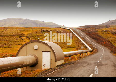 A pipeline taking geothermally heated hot water from Hellisheidi geothermal power station in Hengill, to Reykjavik, Iceland. - Stock Image