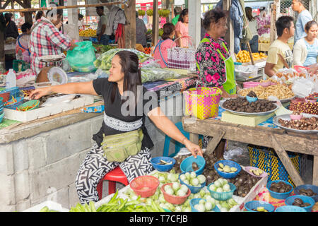 Nakhon SI Thammarat, Thailand-February 11th 2015. Vendors selling vegetables on the market. The market is open every morning. - Stock Image
