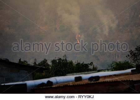 Wild fires burn in the mountains near Jinotega, Nicaragua.  Illegal brush fires have been burning for around a week - Stock Image