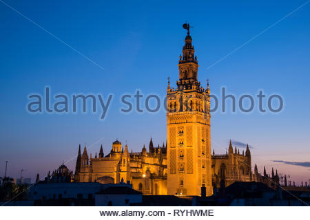 The Giralda Bell Tower of Seville Cathedral at dusk - Stock Image