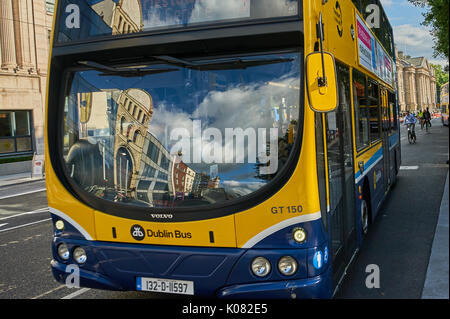 Blue and yellow double decker bus in Dublin city centre - Stock Image