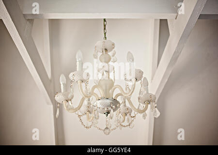 Low angle view of chandelier hanging from ceiling - Stock Image