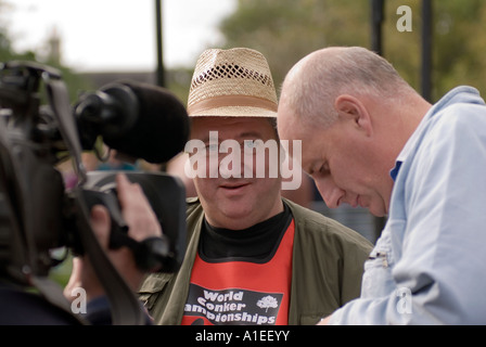 Chris Jones being interviewed for television after winning the  42nd World Conker Championships at Ashton Northamptonshire - Stock Image