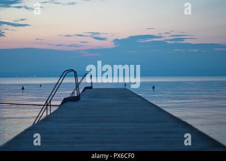 Boardwalk at the lake during sunset - Stock Image