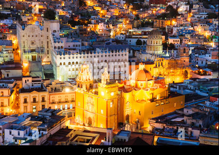 The cathedral and the University of Guanajuato are seen at night from above. - Stock Image