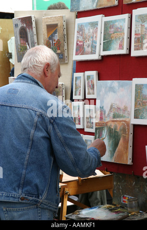 Artist at work in the artists quarter Montmartre Paris France Europe - Stock Image