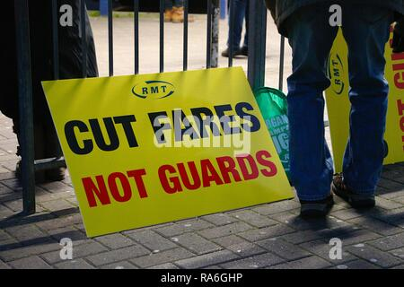 Hastings, East Sussex, UK. 2nd Jan, 2019. A peaceful protest is taking place outside Hastings train station in solidarity with other protests nationwide regarding the 3.1% increase in fares. A banner which reads cut fares not guards on display at the protest. Credit: Paul Lawrenson/ Alamy live news - Stock Image