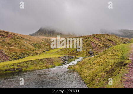 The Black Mountain range (Carmarthen Fans) with Fan Brycheiniog enshrouded in clouds during winter in the Brecon Beacons National Park, Wales, UK - Stock Image