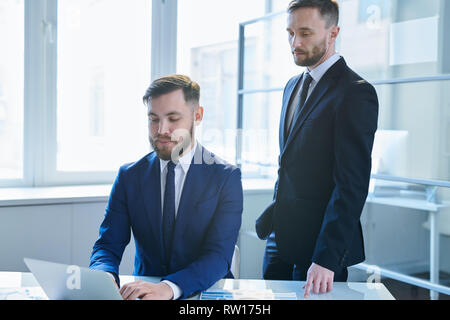 Subordinate and employer - Stock Image