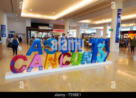 Cancun airport Mexico - interior of terminal 3 with sign and people, Cancun, Mexico - Stock Image