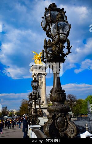 Lamps and towers of the iconic Pont Alexandre III over the Seine River in Paris, France - Stock Image