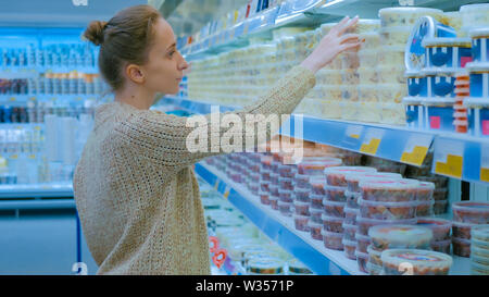 Woman buying sea food at supermarket - Stock Image