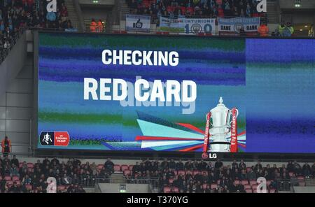 VAR checks for the possible red card incident in first half during the FA Cup Semi Final match between Brighton & Hove Albion and Manchester City at Wembley Stadium . 6 April 2019 Editorial use only. No merchandising. For Football images FA and Premier League restrictions apply inc. no internet/mobile usage without FAPL license - for details contact Football Dataco - Stock Image
