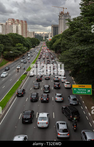 View of an avenue (Av. Vinte e Tres de Maio) were bursting with vehicles in one direction. Heavy traffic plagues Sao Paulo downtown, Brazil - Stock Image