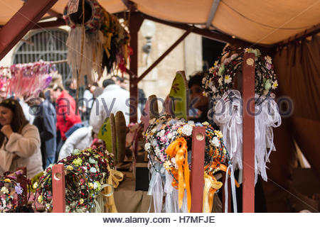 Handmade colored flower headbands.They are sold in medieval markets and are very popular among  girls who visit - Stock Image