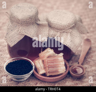 Honey with black cumin with honey comb - Stock Image
