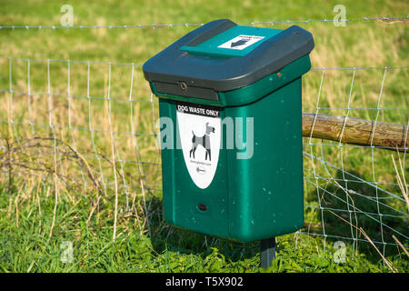Green Dog Waste Bin at Wicken Fen, Cambridgeshire, East of England, England, UK. - Stock Image