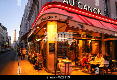 Cafe Au Canon des Invalides is typical French cafe located near the Eiffel tower in Paris, France. - Stock Image
