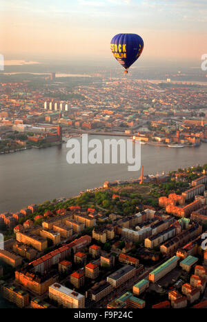 Hot air balloon floating over Södermalm and islands of Stockholm with City Hall on Riddarfjarden waters at - Stock Image