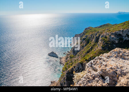View on amazing bay, boats and ships with swimming people in Ionian Sea blue water near to Blue Caves. Famous sightseeing point. Greece holidays vacations tours tourism. Greece islands boat tours - Stock Image