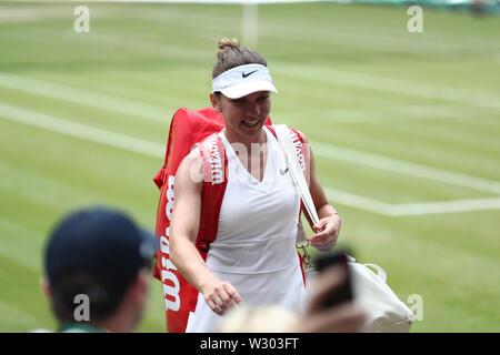 Wimbledon, UK. 11th July 2019, The All England Lawn Tennis and Croquet Club, Wimbledon, England, Wimbledon Tennis Tournament, Day 10; Simona Halep (rom) leaves the court as she wins the match 2 sets to love against Elina Svitolina (ukr) during their ladies singles semi-final match Credit: Action Plus Sports Images/Alamy Live News - Stock Image