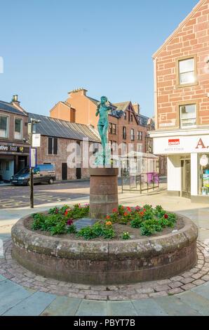 A view of a statue of Peter Pan on Glengate in Kirriemuir in Sctoalnd in memory of  Sir J M Barrie who was born in Kirriemuir. - Stock Image