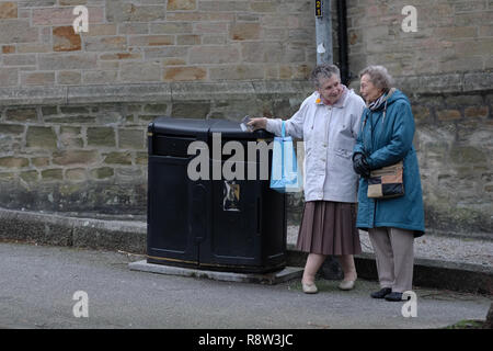 Two old ladies talking in the street. - Stock Image