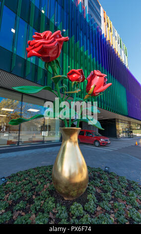 Helsinki New Children's Hospital opened for patients on 17 September 2018. Its colourful facade has sculpture with three red roses in a golden vase. - Stock Image