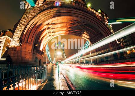 Fisheye view of traffic trail lights on Tower Bridge at night, Southwark, London, England, United Kingdom, Europe - Stock Image