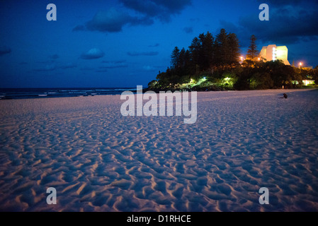 Looking towards Pat Fagan Park over teh sand on the headland at Coolangatta at dusk. Sometimes paired as 'Twin - Stock Image