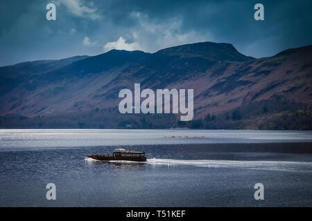 A ferry transports passengers across Derwentwater lake, Cumbria, UK. - Stock Image